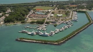 AX0025_103 - 5K stock footage aerial video of flying by fishing boats docked, Plantation Yacht Harbor Resort, Islamorada, Florida