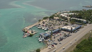 AX0025_109 - 5K stock footage aerial video of Whale Harbor Restaurant and Marina, Chesapeake Beach Resort, Islamorada, Florida