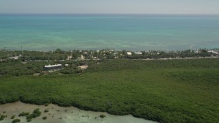 AX0025_117 - 5K stock footage aerial video of flying by Resorts and Marinas along the shore, Islamorada, Florida
