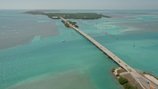 AX0025_120E - 5K stock footage aerial video follow Overseas Highway, approach Lower Matecumbe Key, Islamorada, Florida