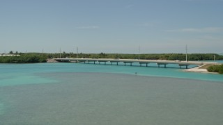 AX0025_123 - 5K stock footage aerial video of flying by a bridge on the Overseas Highway, Islamorada, Florida
