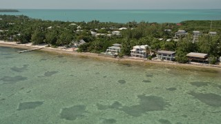 AX0025_125 - 5K stock footage aerial video of oceanfront homes on the coast in Islamorada, Florida