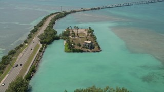 AX0025_134 - 5K stock footage aerial video of approaching an oceanfront home on Craig Key, Florida