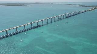 AX0025_135 - 5K stock footage aerial video of approaching Overseas Highway bridge to Fiesta Key, Florida