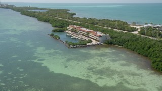 AX0025_138 - 5K stock footage aerial video of following coast towards apartment buildings, Layton, Florida