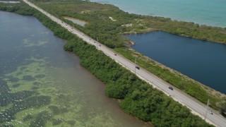 AX0025_139 - 5K stock footage aerial video of panning across Overseas Highway, revealing neighborhood, Layton, Florida