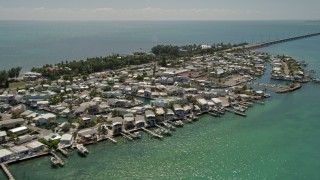 AX0025_142 - 5K stock footage aerial video of approaching and flying by coastal neighborhood, Long Key, Layton, Florida