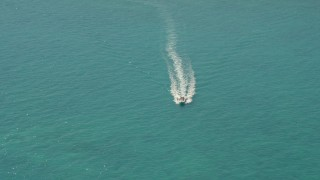 AX0025_144 - 5K stock footage aerial video approach speedboat near Overseas Highway, Conch Key, Marathon, Florida