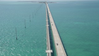 AX0025_145 - 5K stock footage aerial video of following Overseas Highway to Conch Key, Marathon, Florida