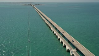 AX0025_145E - 5K stock footage aerial video of following Overseas Highway to Conch Key, Marathon, Florida