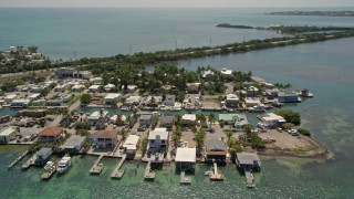 AX0025_147 - 5K stock footage aerial video of flying by small neighborhood on Conch Key, Marathon, Florida