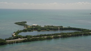 AX0025_148 - 5K stock footage aerial video of flying by Conch Key Cottages, Little Conch Key, Marathon, Florida