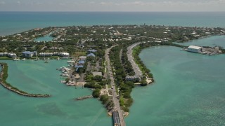 AX0025_150 - 5K stock footage aerial video of flying by homes on Duck Key, Marathon, Florida