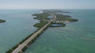 AX0025_151 - 5K stock footage aerial video of flying by Overseas Highway, pan right to reveal Grassy Key, Marathon, Florida