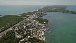 AX0025_153 - 5K stock footage aerial video of flying by Pelican Carefree RV Resort, Marathon, Florida