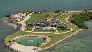 AX0025_158E - 5K stock footage aerial video of orbiting mansion on Long Point Key, Marathon, Florida