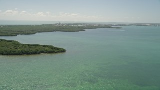 AX0025_161 - 5K stock footage aerial video of flying by coastal mangroves, Fat Deer Key, Marathon, Florida