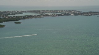 AX0025_162 - 5K stock footage aerial video of tracking speed boat off the shore, Fat Deer Key, Marathon, Florida