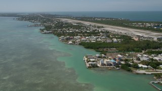 AX0025_165 - 5K stock footage aerial video of flying by neighborhoods near Florida Keys Marathon Airport, Marathon, Florida