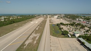 AX0026_001 - 5K stock footage aerial video of lifting off from Florida Keys Marathon Airport, Marathon, Florida