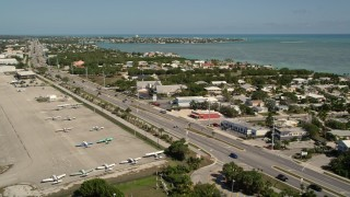 AX0026_002 - 5K stock footage aerial video fly by Overseas Highway, Florida Keys Marathon Airport, Marathon, Florida