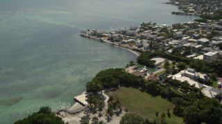 AX0026_003 - 5K stock footage aerial video of approaching coastal homes by the water, Marathon, Florida