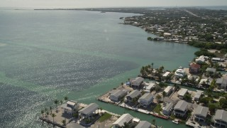 AX0026_004 - 5K stock footage aerial video flying over the Atlantic Ocean near homes on the coast, Marathon, Florida