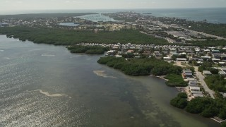 AX0026_006 - 5K stock footage aerial video of following coast, approaching Sombrero Country Club, Marathon, Florida