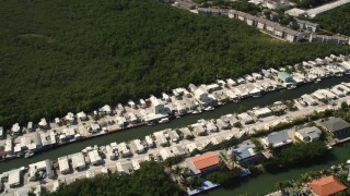 AX0026_007 - 5K stock footage aerial video of homes on coastal canal, Marathon, Florida
