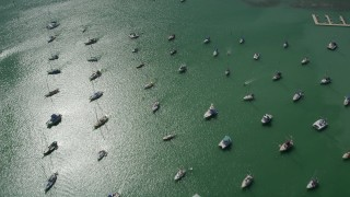 AX0026_010 - 5K stock footage aerial video of flying by sailboats and fishing boats in Boot Key Harbor, Marathon, Florida