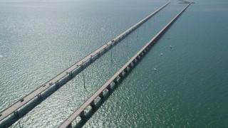AX0026_016 - 5K stock footage aerial video of tracking light traffic on the Seven Mile Bridge, Marathon, Florida