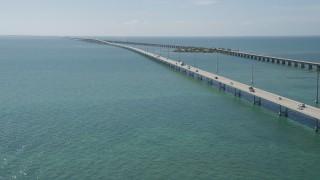AX0026_019 - 5K stock footage aerial video of light traffic crossing the Seven Mile Bridge, Florida