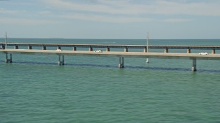 AX0026_020 - 5K stock footage aerial video of a view of light traffic on the Seven Mile Bridge, Florida