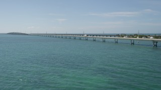 AX0026_021 - 5K stock footage aerial video of flying by light traffic on the Seven Mile Bridge, Florida