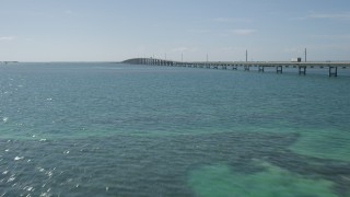 AX0026_022 - 5K stock footage aerial video of approaching light traffic on Seven Mile Bridge, Florida