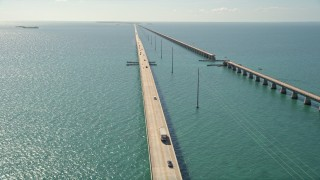 AX0026_023 - 5K stock footage aerial video fly over Atlantic Ocean, reveal light traffic on Seven Mile Bridge, Florida
