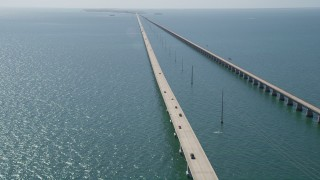 AX0026_024 - 5K stock footage aerial video of following light traffic traveling on Seven Mile Bridge, Florida