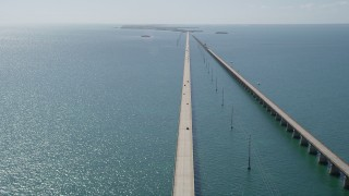 AX0026_027 - 5K stock footage aerial video of crossing over the bridge with light traffic, Seven Mile Bridge, Florida