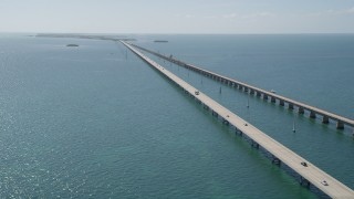 AX0026_028 - 5K stock footage aerial video of following the bridge with light traffic, Seven Mile Bridge, Florida