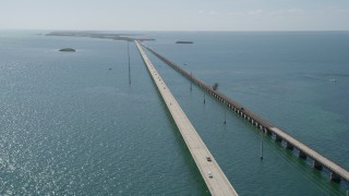 AX0026_029 - 5K stock footage aerial video of cars crossing the Seven Mile Bridge, Florida