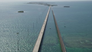 AX0026_030 - 5K stock footage aerial video of tilting to light traffic on the Seven Mile Bridge, Florida