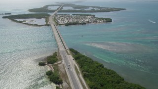 AX0026_033 - 5K stock footage aerial video of Overseas Highway, Sunshine Key RV and Camping Resort, Ohio Key, Florida