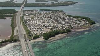 AX0026_033E - 5K stock footage aerial video of Overseas Highway, Sunshine Key RV and Camping Resort, Ohio Key, Florida