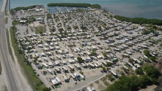 AX0026_034 - 5K stock footage aerial video of approaching Sunshine Key RV and Camping Resort, Ohio Key, Florida