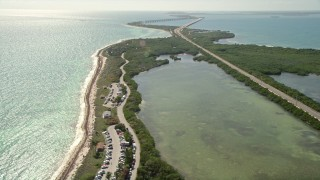AX0026_035 - 5K stock footage aerial video of flying over Bahai Honda State Park, approaching the beach, Bahai Honda Key, Florida