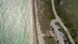 AX0026_036 - 5K stock footage aerial video of bird's eye view of people on the beach, Bahai Honda Key, Florida