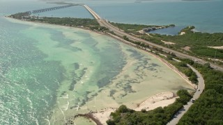 AX0026_037 - 5K stock footage aerial video of flying by the Overseas Highway and the coast of Bahai Honda Key, Florida