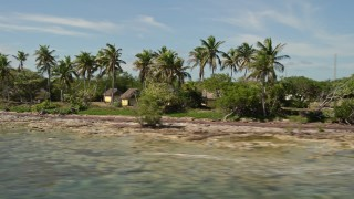 AX0026_042 - 5K stock footage aerial video of huts for Girl Scout Camp Wesumkee on Scout Key, Florida