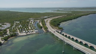 AX0026_045 - 5K stock footage aerial video of following Overseas Highway past Big Pine Key Fishing Lodge, Big Pine Key, Florida