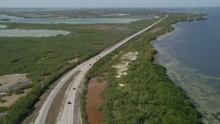 AX0026_046 - 5K stock footage aerial video of flying over Overseas Highway at Big Pine Key, Florida
